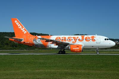 "easyJet (easyJet.com) (UK) Airbus A319-111 G-EZBI (msn 3003) (William Shakespeare - ""Romeo Alpha Juliet"") ZRH (Rolf Wallner). Image: 929125."