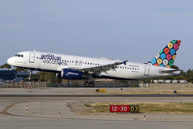 "JetBlue's 2018 ""jetBlue vacations"" logo jet"