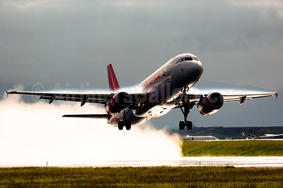 An Avianca Airbus A320 in the damp morning mist